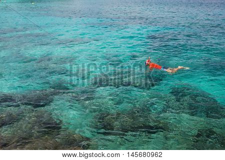 Man snorkeling in beautiful blue Indian ocean