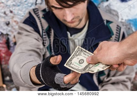Donation To Homeless Man