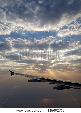 Sunrise Traveling Through Beautiful Nimbus Clouds And Orange Sun Rays