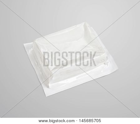 Block Of White Vacuum Soft Wrap Box Package On Gray Background