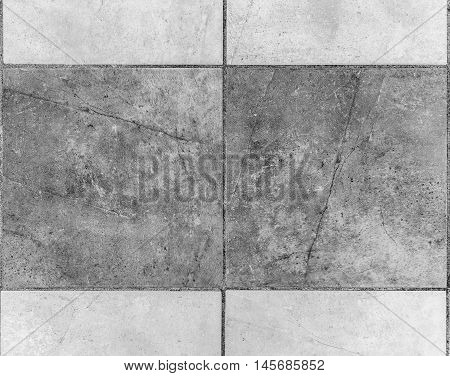 Outside Terrace Ceramic Tiles. Image of exterior flooring with grey pavement slabs.