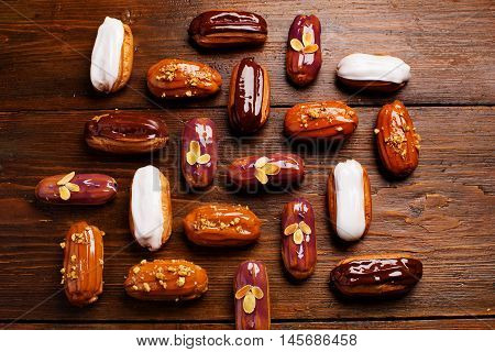 Eclairs On Wooden Table