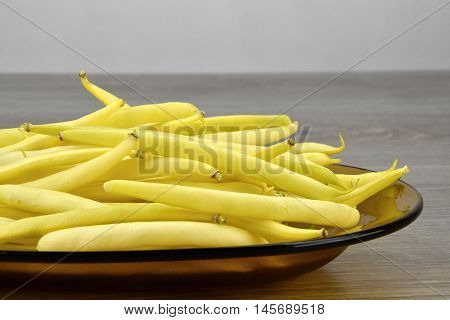 Yellow bean pods on the glass plate detail