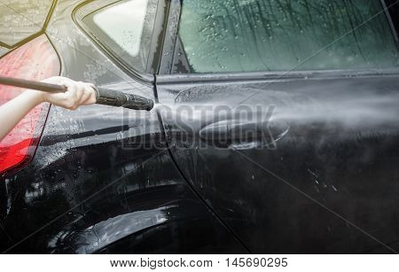 Car Washing. Cleaning Car Using High Pressure Water by woman,woman can wash,woman can do