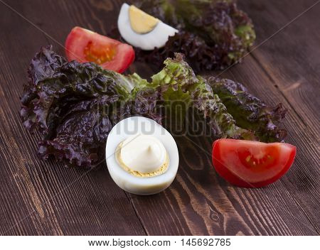 Half Of Boil Egg Handful Of Mayonnaise. Egg, Tomato, Lettuce On A Wooden Background.