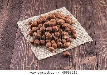 Hazelnuts on rustic background. Hazelnut kernels placer.