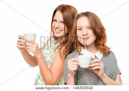 Portrait Of A Beautiful Female Friends With Tea On A White Background