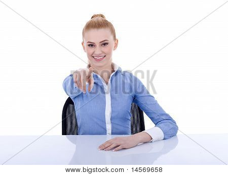 Businesswoman Behind The Desk Pointing At You