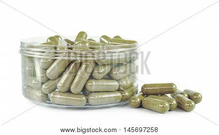 Herbal drugs capsules isolated on white .