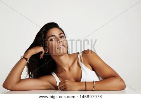 spanish woman in studio photoshoot with nude makeup