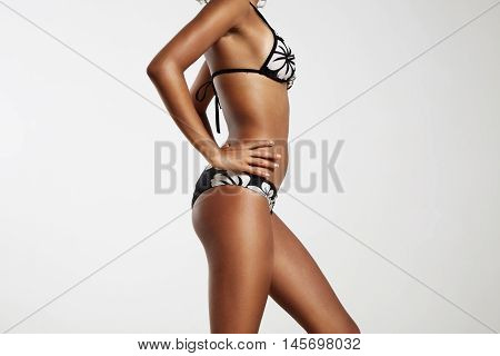 Perfect Fit Woman In Bikini In Profile. Beauty Body Concept