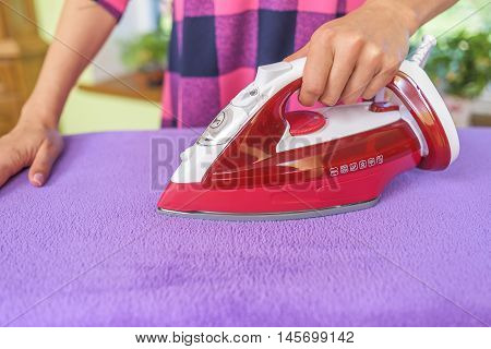 Ironing The Clothes.