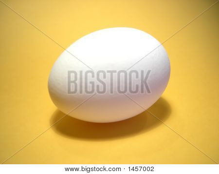 Egg Over A Yellow Background