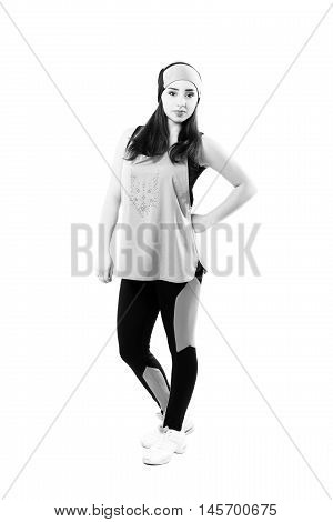 young professional cheerleaders posing at studio. Isolated over white. Black and white photography
