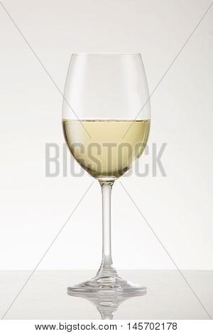 White wine g lass with white wine cultivar.