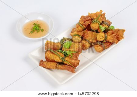 Gold bar and gold bag ,Deep fried Chinese sheet wrap minced pork by shallot,served with sweet sauce on white background. Side view