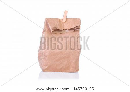 Paper bag , lunch bag with wooden clothes pin on white background with clipping path