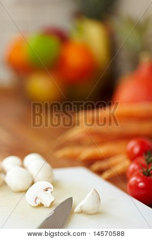 Knife Cutting White Mushrooms