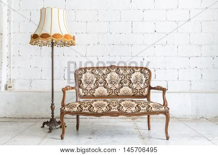 Brown Classical style sofa couch in vintage room with desk lamp