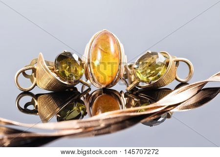 Gold Ring With Amber And Earrings With Green Stones
