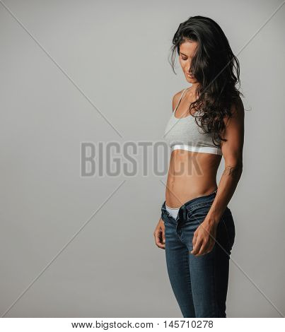 Slender Muscular Woman With Long Brown Hair