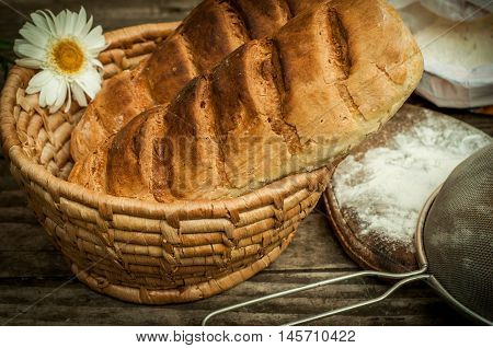 Homemade bread on an old table closeup