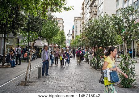 ATHENS GREECE - APRIL 25 2016: view of Ermou street in Athens with crowd