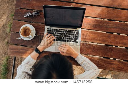 Woman Using Her Laptop At A Coffee Shop