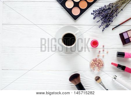 make up set on white table with lavender, coffe cup top view