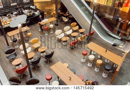VIENNA, AUSTRIA - JUN 6, 2013: Urban city cafe inside the moderm shopping mall with customers on June 6, 2013. Vienna city has population near 1.8 million