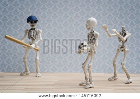 Two skeletons use their friend's head playing baseball