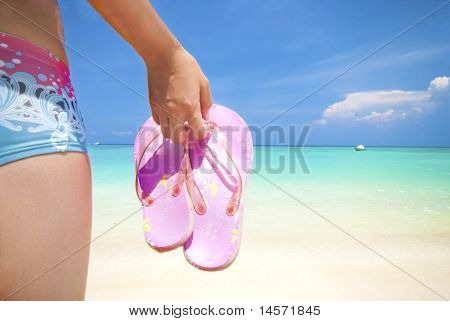 Asian Girl On A Beach Holding Slipper