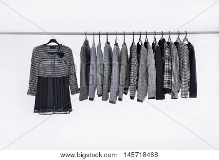 Row of female clothes of different coat hangers
