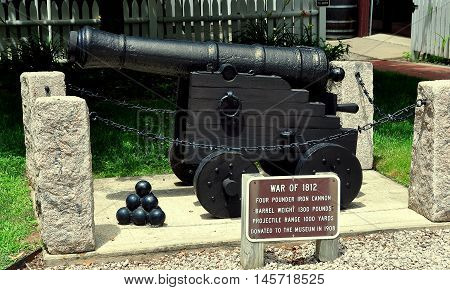 Guilford Connecticut - July 10 2015:: A four pounder iron cannon from the War of 1812 is displayed at the 1639 Henry Whitfield House and Museum