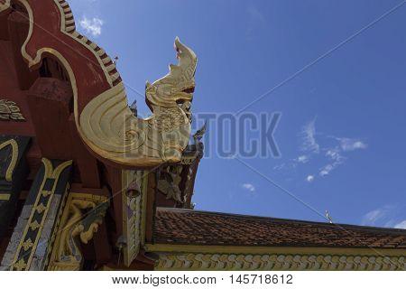 golden naga sculpture in buddhism temple monastery