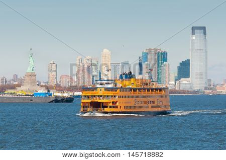 New York City USA - November 18 2011: Staten Island Ferry in New York Harbor with the Statue in the background on November 18 2011.