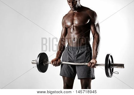 African Sportsman Exercising With Barbell
