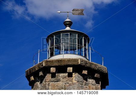 Stonington Connecticut - July 10 2015: Weathervane and former glassed in light at the 1840  granite Old Lighthouse Museum on the East Side of Stonington Harbor