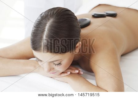 Girl on a stone therapy hot stone massage