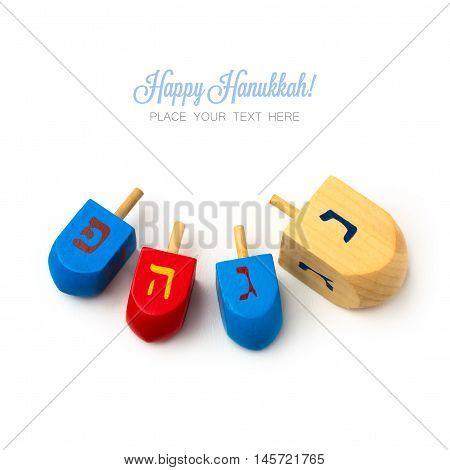 Hanukkah wooden dreidel spinning top isolated on white background