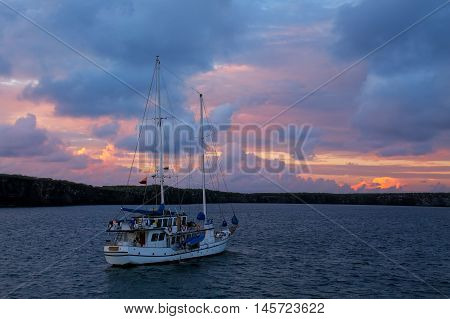 Sailboat In Great Darwin Bay At Sunrise, Genovesa Island, Galapagos National Park, Ecuador