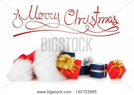 Merry Christmas concept text and red santa hat with gift boxes isolated on white background