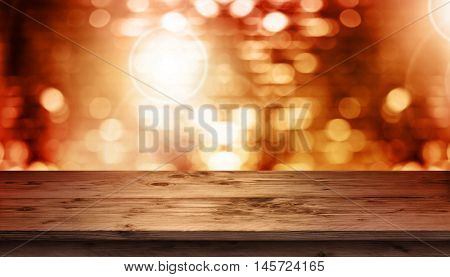 Birthday party background with colorful glitter in front of a wooden table