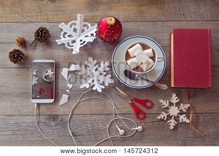 Christmas holiday celebration. Preparing paper snowflakes. View from above.