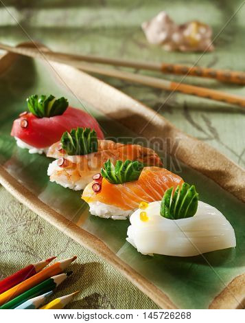 sushi with chopsticks. Japanese cuisine for kids