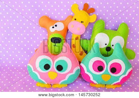 Crafts out of felt. Felt handmade toy owl, bear, cat, giraffe. Funny children toys