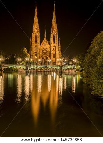 Saint Paul church from Strasbourg at night Strasbourg France night photography with the beautiful St. Paul church with its two majestic towers and their water reflection