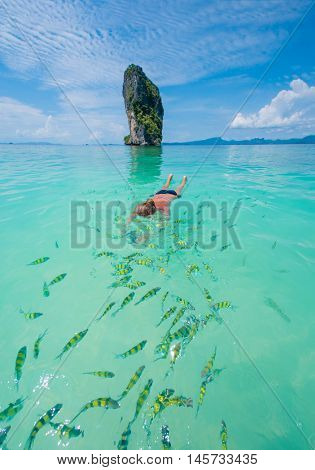 Woman swimming with snorkel, Andaman Sea Poda island, Thailand