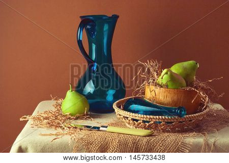 Still life with pears and blue jug