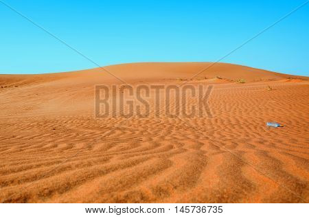 Dunes background.Arid desolate landscape.Footprints in the sand.Structure of waves in the sand.Dunes in the desert.Adventure trip to desert nature.